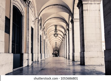 typical covered walkway, the portico of placa do comercio, lisbon, portugal