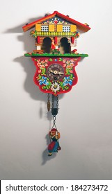 Typical cuckoo clock over a white wall