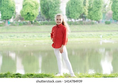 A typical day in childhood. Happy little girl wearing casual clothes for vacation at riverside. Childhood activities on summer day. Happy childhood. Childhood and growing up.