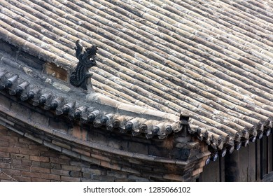 Typical decorated roofs of the houses of Pingyao Ancient city, Shanxi province, China. Known as one of the best preserved villages of China, Pingyao is a UNESCO World Heritage Site