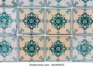 Typical decoration of the facade of the house in Lisbon. Traditional ceramic tiles Azulejos.