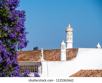 Typical decorative chimneys on the roofs of homes, Algarve, Portugal