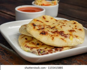 Typical delicious flour tortillas with cheese and beans from El Salvador, pupuseria, pupusa.