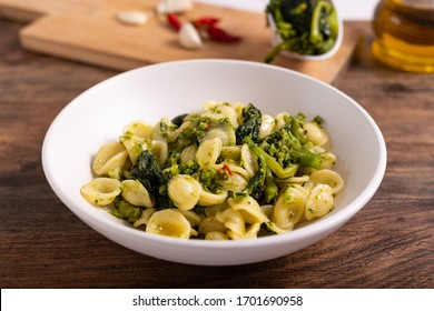 Typical dish of Italian cuisine, orecchiette with turnip greens. Orecchiette with cime di rapa, vegan food, healthy dish, fast lunch.