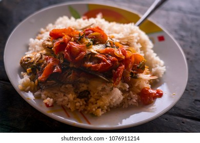 Typical dish from the peruvian amazon with fish, rice, tomatoes and onions, near iquitos, peru