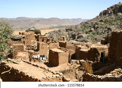 A typical Dogon city of mud sits on the  hillside of the Bandiagara Escarpment of Mali, Africa
