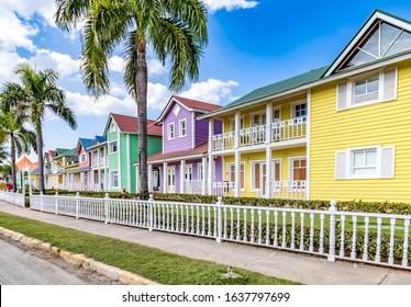 Typical dominican colorful wood houses, palm trees on an emblematic downtown street, Samana, Dominican Republic