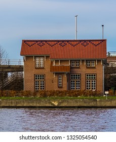 typical dutch bungalow at the water side, Architecture of Alphen aan den Rijn, The Netherlands