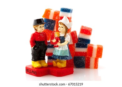 Typical Dutch couple with candy isolated over white