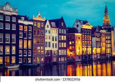 Typical dutch dancing houses at dusk in Amsterdam, Netherlands