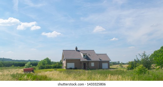 Typical Dutch house standing in a polder