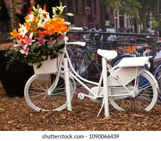 Typical Dutch scenery with white bicycle in Amsterdam