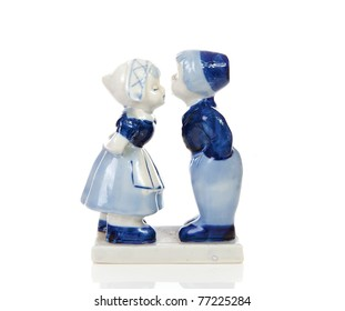 Typical Dutch souvenir in Delft blue over white background