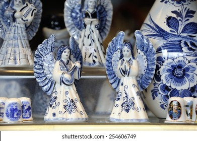 Typical Dutch souvenir of two angels in Delft Blue at a souvenir shop in Delft,Netherlands