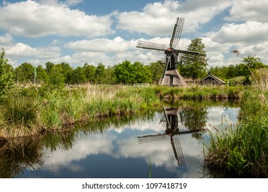 Typical dutch spinnekop mill in the national landscape the weerribben and wieden near Giethoorn and Kalenberg. It is suitable for the drainage of small polders Typical traditional Dutch windmill