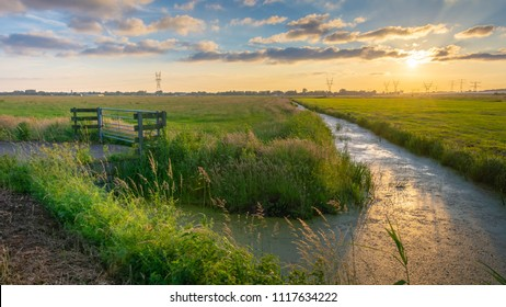 Typical Dutch sunset on farmland in the center of the Netherlands near Weesp