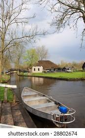 typical dutch village beside river