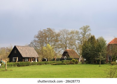 typical dutch village in a cloudy day