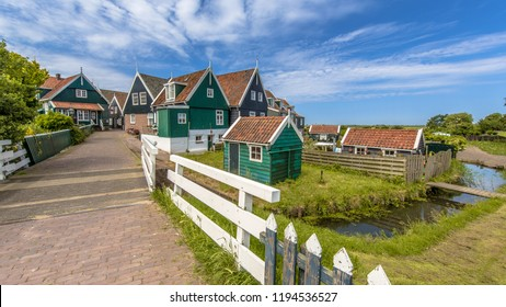 Typical Dutch village scene with wooden houses and bridge over canal on the island of Marken in the Ijsselmeer or formerly Zuiderzee, the Netherlands