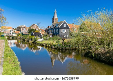 Typical Dutch village scene with wooden houses on the island of Marken in the Netherlands, Holland