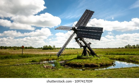 Typical dutch windmill in the national landscape the weerribben and wieden near Giethoorn and Kalenberg. It is suitable for the drainage of small polders.