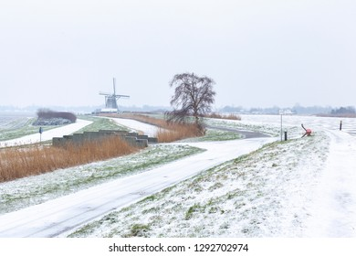 Typical dutch winter landscape with windmill