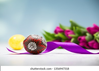 Typical easter egg from Slovakia with ribbon and tulips.
