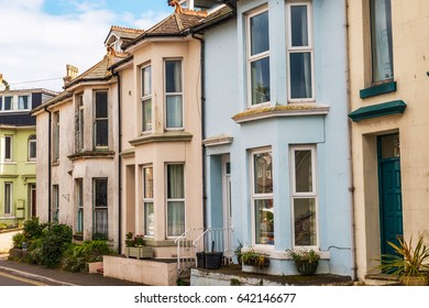 Typical English architecture, residential buildings in a row along the street, seaside town