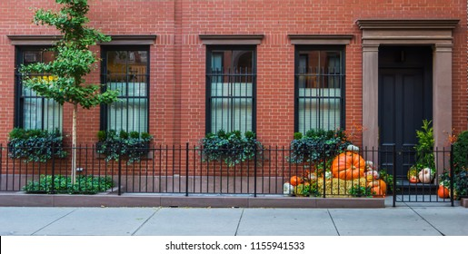 Typical facade in Greenwich village before Halloween with pumpkins near the door