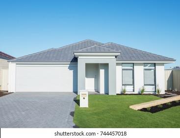 typical facade of a modern suburban house against blue sky