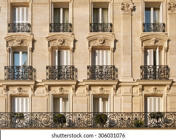 Typical facade of Parisian building near Notre-Dame