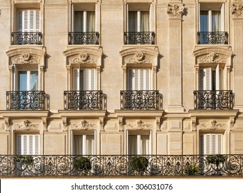 Typical facade of Parisian building with window wrought iron fences near Notre-Dame in French capital
