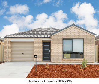 typical facade of a small modern suburban house against  cloudy sky
