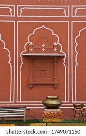 Typical facades of red and pink traditional houses in central Jaipur. Rajasthan, India