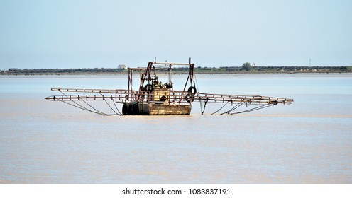 typical fishing boat on the Guadalquivir River in Doñana National Park, Spain,