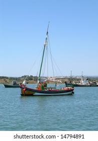 typical fishing wooden sail boat, in the alvor estuary, algarve portugal