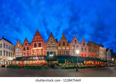 Typical Flemish colored houses on the Grote Markt or Market Square in the center of Bruges during evening blue hour, Belgium