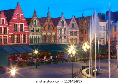 Typical Flemish colored houses on the Grote Markt or Market Square in the center of Bruges during morning blue hour, Belgium