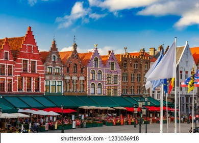 Typical Flemish colored houses on the Grote Markt or Market Square in the center of Bruges, Belgium