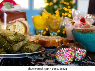 Typical food of the Venezuelan Christmas celebration, which includes hallacas, ham bread, panetone, caramel and peach sweets, chicken salad and pork leg.