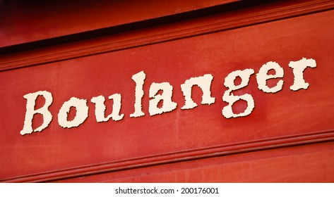 "Typical French bakery shop sign (""boulanger"" on French means ""baker""). Paris, France."