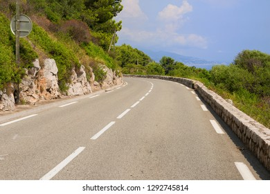 Typical french road / corniche between Nice and Monaco with ocean in background