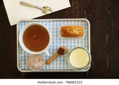 A typical French tea gourmand, serving with mini sweet desserts such as chocolate, cream caramel, chou creme and a small piece of cake.