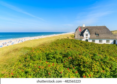 Typical Frisian house with straw roof on cliff at Kampen beach, Sylt island, Germany