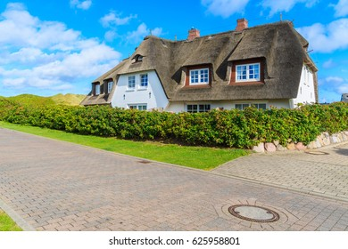 Typical Frisian house with thatched roof in Wenningstedt seaside village on Sylt island, North Sea, Germany