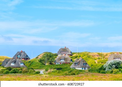 Typical Frisian houses with straw roofs on sand dunes in Kampen village, Sylt island, Germany