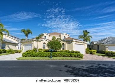 Typical gated community houses with palms, South Florida