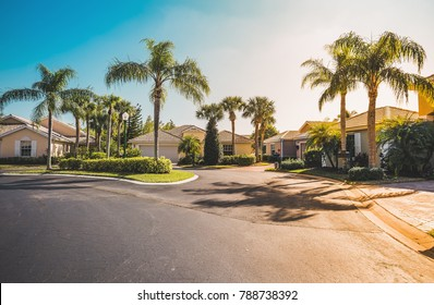 Typical gated community houses with palms, South Florida. Light effect applied