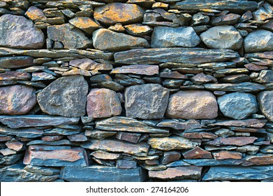Typical Georgian wall stacked from mountain rocks. Georgia