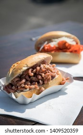 Typical German Friesland fish buns with north sea crabs and on wooden table during fish market as fast regional snack